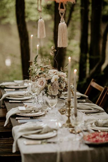 Elegant Tablescape in the Woodland with Candle Light and Floral Arrangement