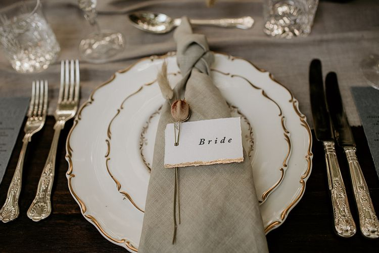 Elegant Place Setting with Ornate Tableware and Linen Napkin