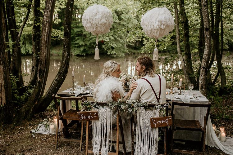 Boho Bride and Groom Sitting at Woodland Tablescape