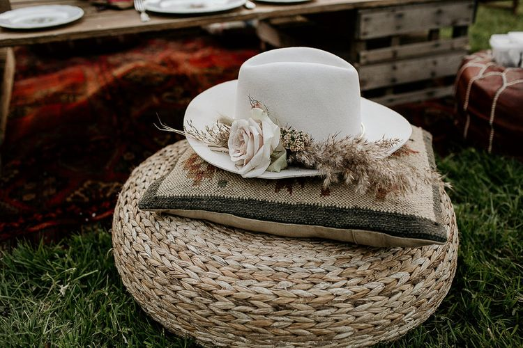 Wicker Pouf, Moroccan Cushion and Flower Covered Fedora Hat