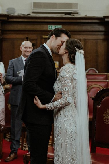 Wedding Ceremony | Bride in Beaded Needle & Thread Wedding Dress with Long Sleeves | Groom in Marks & Spencer Suit with Olive Tie | Britten Veil | Tania Maris Hairpiece | Islington Town Hall | Beaded Needle & Thread Dress for Intimate Islington Wedding | Olivia & Dan Photography