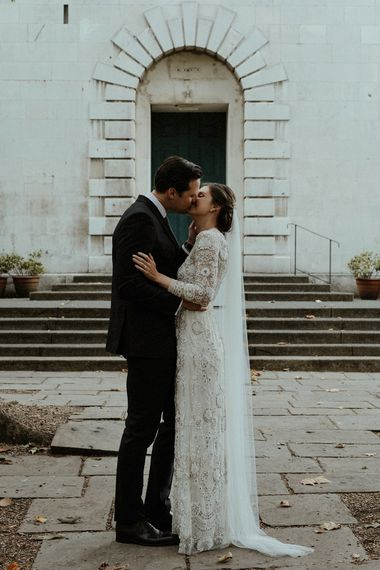 Bride in Beaded Needle & Thread Wedding Dress with Long Sleeves | Groom in Marks & Spencer Suit with Olive Tie | Britten Veil | Beaded Needle & Thread Dress for Intimate Islington Wedding | Olivia & Dan Photography