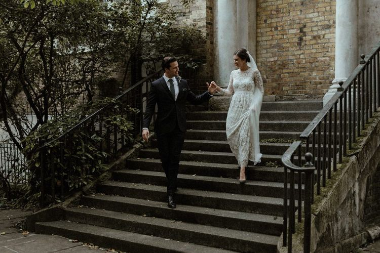 Bride in Beaded Needle & Thread Wedding Dress with Long Sleeves | Groom in Marks & Spencer Suit with Olive Tie | Britten Veil | Tania Maris Hairpiece | Olive Green Sergio Rossi Shoes | Beaded Needle & Thread Dress for Intimate Islington Wedding | Olivia & Dan Photography