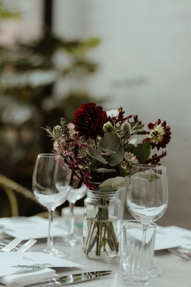 Wedding Reception Decor | Maroon and White Table Flowers with Thistles and Foliage in Mason Jars | Bourne & Hollingsworth Buildings | Greenhouse Reception Venue | Beaded Needle & Thread Dress for Intimate Islington Wedding | Olivia & Dan Photography