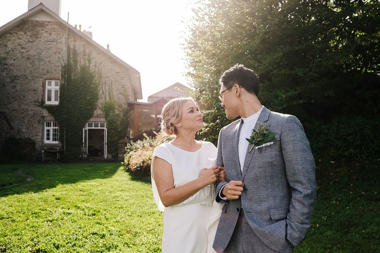 Bride and Groom. Contemporary Meets Rustic Humanist Wedding at Boutique Venue Anran, Devon. Bespoke Bridal Gown. Photography by Kristian Leven