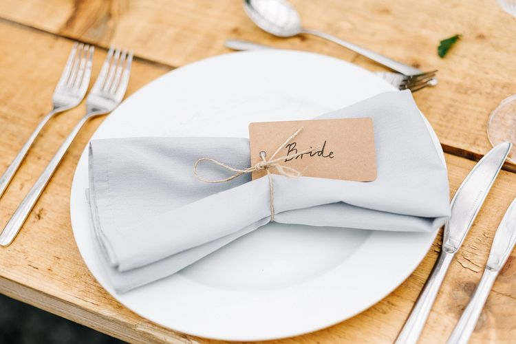 Table Setting. Name Places. Contemporary Meets Rustic Humanist Wedding at Boutique Venue Anran, Devon. Bespoke Bridal Gown. Photography by Kristian Leven