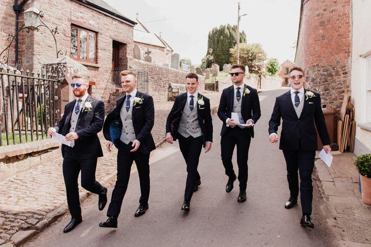 Groomsmen in Navy TM Lewin Three Suits with Grey Waistcoasts