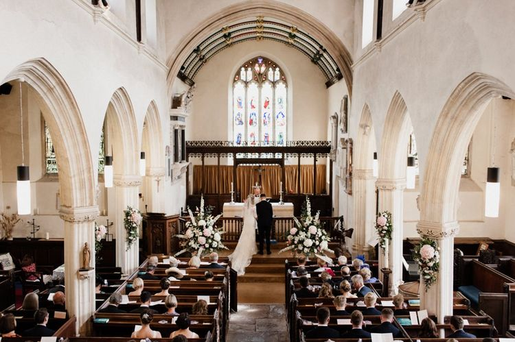 Church Wedding Dress with Bride and Groom at the Altar