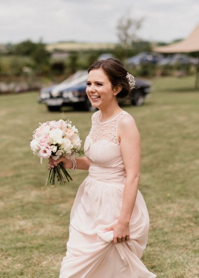 Bridesmaid in Pink Little Mistress Dress Holding a Posey of Pink and White Flowers