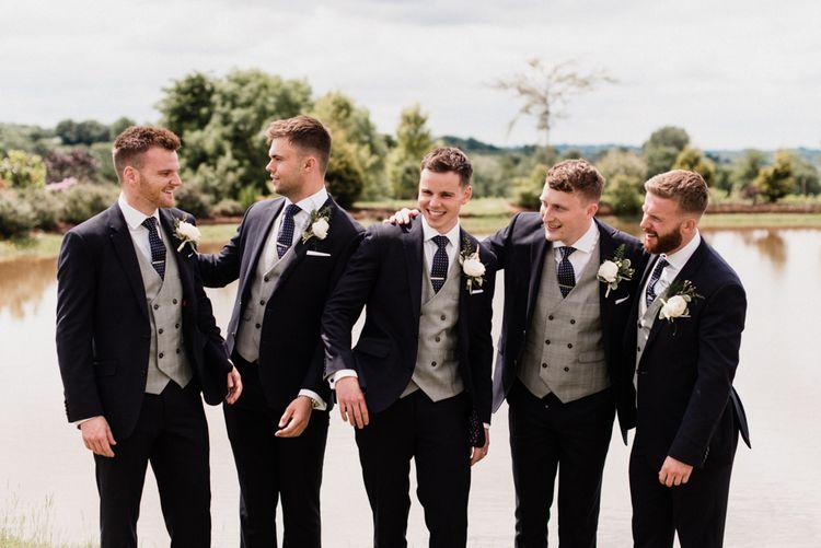 Groomsmen in Navy Suits and Grey Waistcoats