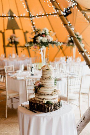 Semi Naked Wedding Cake on Tree Stump Cake Stand  in Tipi Reception