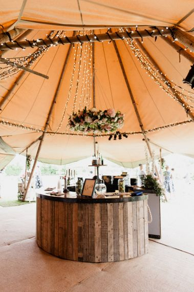 Wooden Bar with Floral Chandelier in Tipi Reception