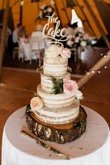 Four Tier Semi Naked Wedding Cake with Flower and Cake Topper Decor