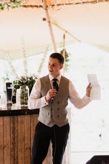 Groom in Navy Trousers and grey Waistcoat Giving His Wedding Speech