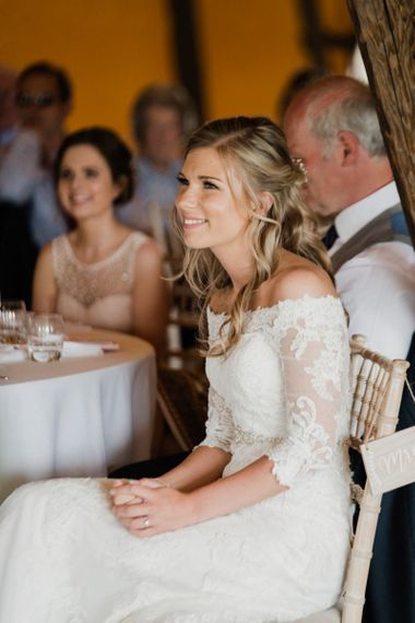 Bride in Lace Off The Shoulder Wedding Dress Enjoying the Wedding Speeches