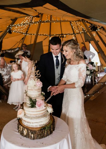 Bride and Groom Cutting the Rustic Wedding Cake