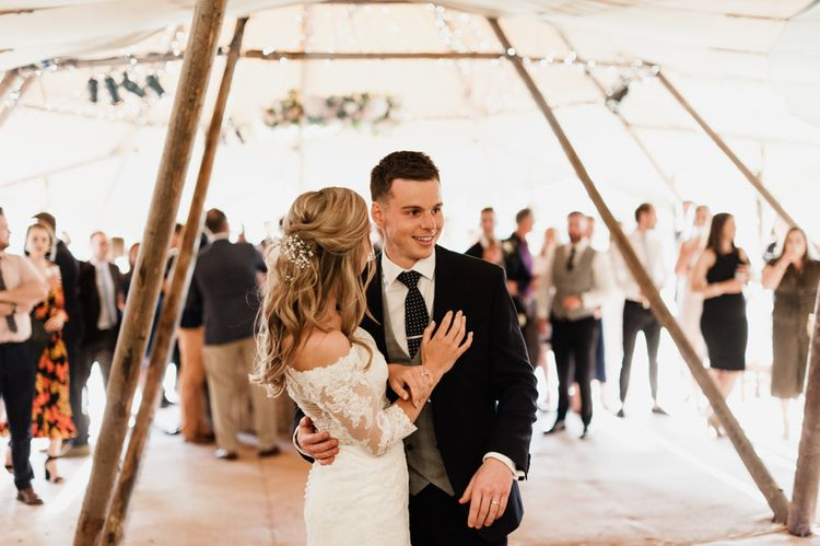 First Dance with Bride in Lace Madeline Gardner Wedding Dress and Groom in TM Lewin Suit