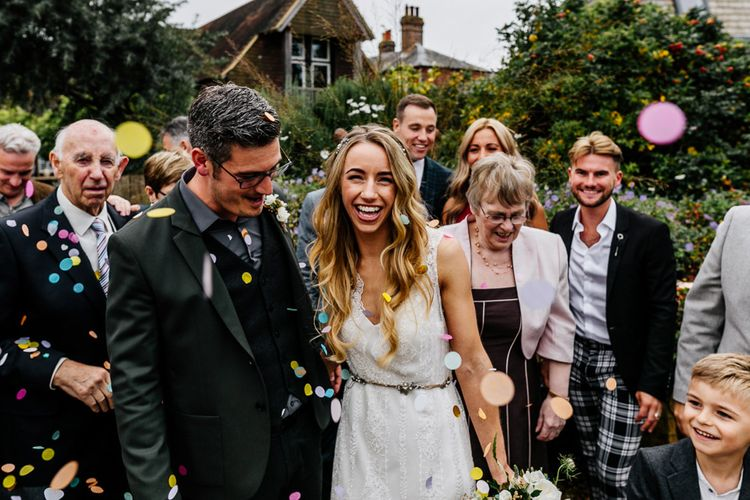 Bride in Charlie Brear Delancey Gown & Belt | Groom in Hugo Boss Suit | Quirky Pub Wedding at The Bell in Ticehurst East Sussex | Epic Love Story Photography