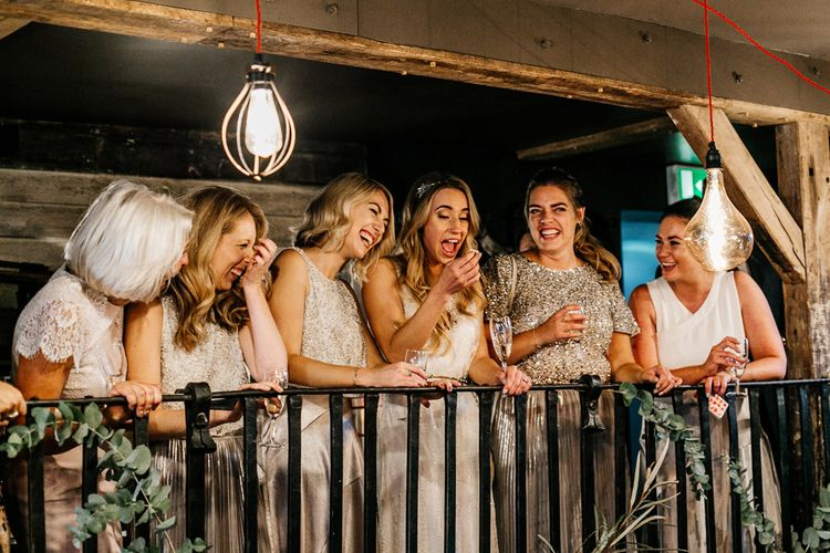Bride in Charlie Brear Delancey Gown & Belt | Bridesmaid in Metallic Skirt & Sequin Top Separates | Quirky Pub Wedding at The Bell in Ticehurst East Sussex | Epic Love Story Photography