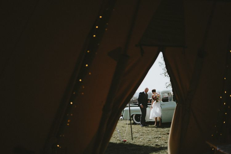 Bride and groom through the tipi