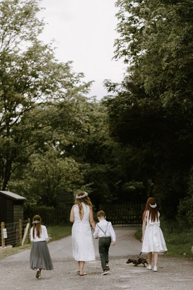 Bride and family make their way to ceremony