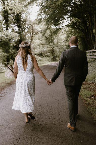Bride wears open back lace tea length wedding dress