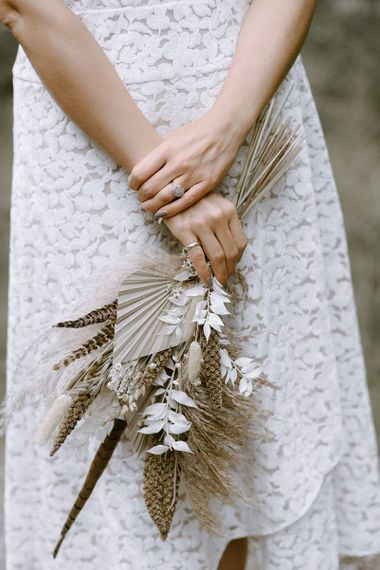 Dried wedding flowers with lace bride dress