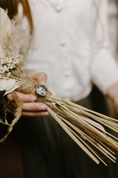 Dried wedding flowers with broach