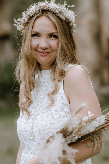 Bride with dried wedding flowers and crown