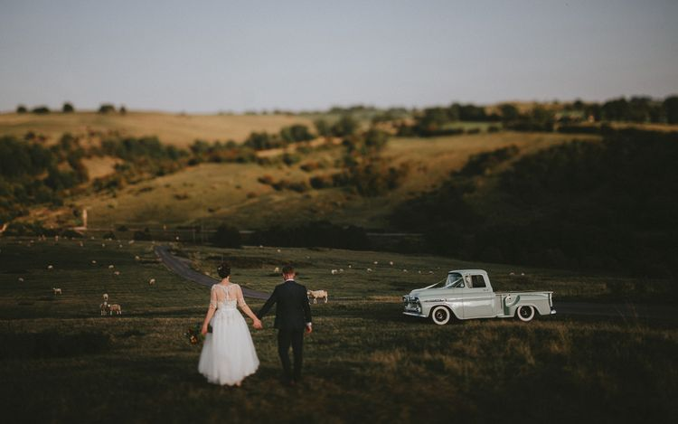 Bride and groom with vintage chevy truck