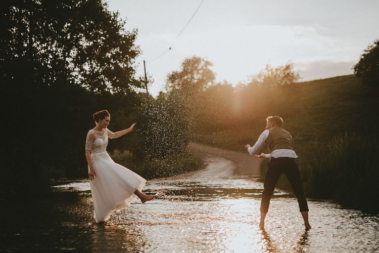 Bride and groom dancing in a ford