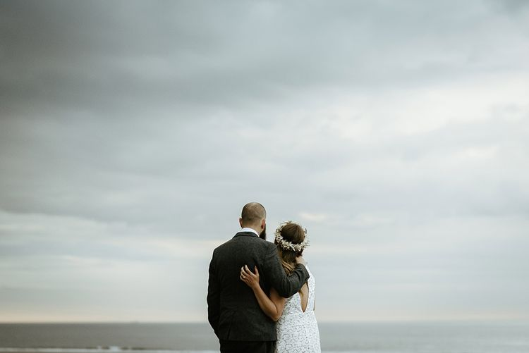 Bride in lace Reiss wedding dress