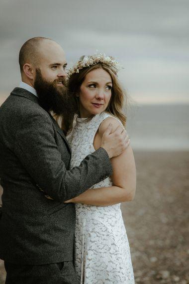Bride wears flower crown and dried flower bouquet