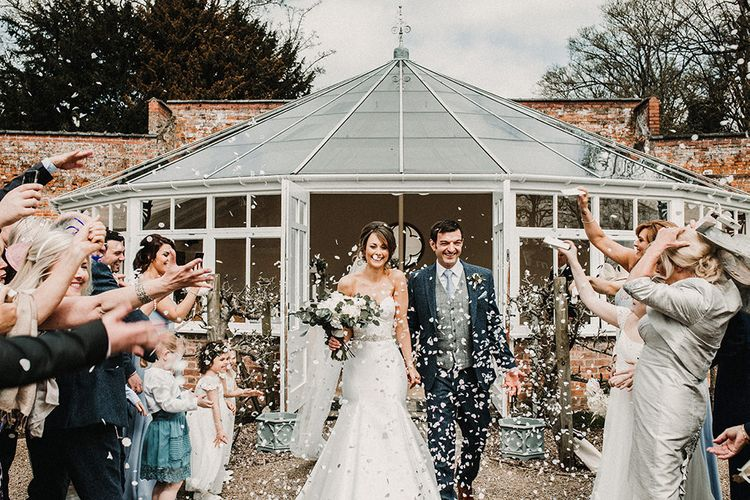 Confetti Exit | Bride in Hourglass Essense of Australia Gown | Groom in Tweed Suit | Sophisticated Wedding at Combermere Abbey, Cheshire | Carla Blain Photography