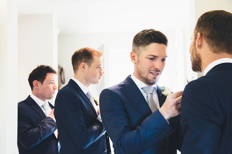 Groomsmen Getting Ready in Navy Suits | Stylish Modern Marquee Wedding at Priory Cottages in the Yorkshire Dales | Leanne Jade Photography