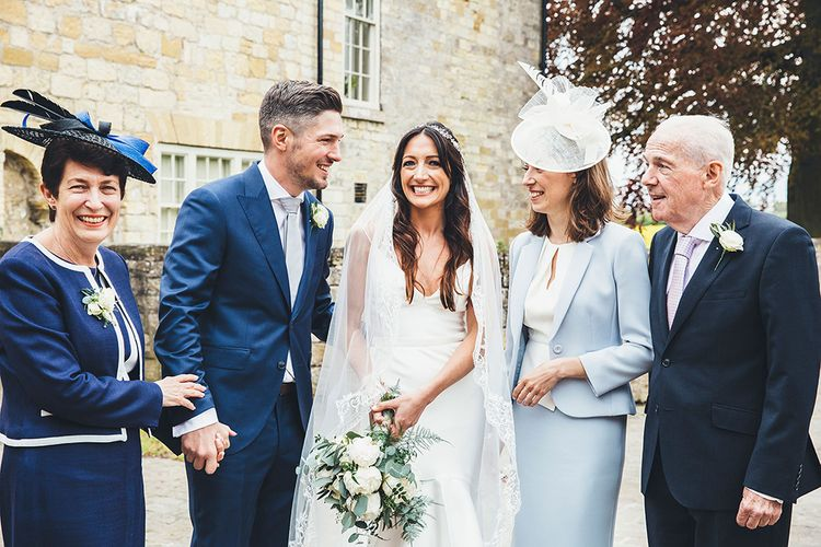 Family Portrait | Bride in Design Your Own Gown By Karen Willis Holmes | Groom in Navy Hackett Suit | Stylish Modern Marquee Wedding at Priory Cottages in the Yorkshire Dales | Leanne Jade Photography