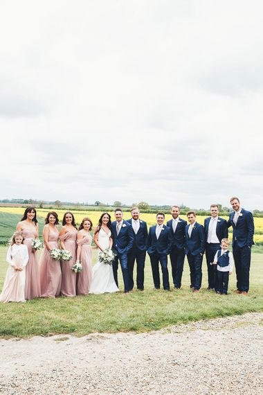 Wedding Party | Bridesmaids in Blush Pink 'Olivia' TH&TH Dresses | Bride in Design Your Own Gown By Karen Willis Holmes | Groomsmen in Navy Suits | Stylish Modern Marquee Wedding at Priory Cottages in the Yorkshire Dales | Leanne Jade Photography