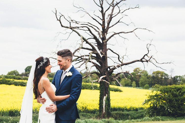 Bride in Design Your Own Gown By Karen Willis Holmes | Groom in Navy Hackett suit | Stylish Modern Marquee Wedding at Priory Cottages in the Yorkshire Dales | Leanne Jade Photography