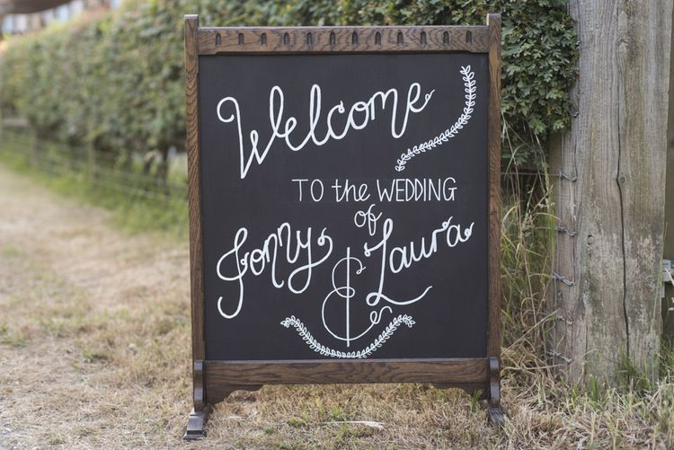 Chalkboard Welcome Sign | Morris Minor Wedding Car, Hanging Flowers in Bottles and Town Crier for Village Hall Wedding in Rye | Eleanor Jane Photography