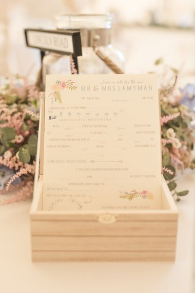 Wedding Advice Cards | Flower Garland Centrepieces | Tipi Wedding Reception at Udimore Village Hall, East Sussex | Morris Minor Wedding Car, Hanging Flowers in Bottles and Town Crier for Village Hall Wedding in Rye | Eleanor Jane Photography