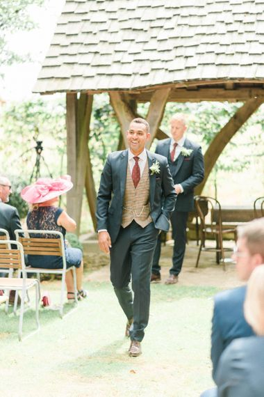 Groom in Dark Suit with Check Waistcoat and Burgundy Tie