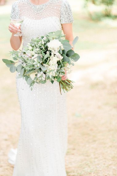 Bride in Jenny Packham Beaded Wedding Dress Holding White and Green Wedding Bouquet