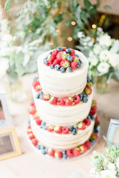 Wedding Cake with Buttercream Icing and Berry Fruit Decor