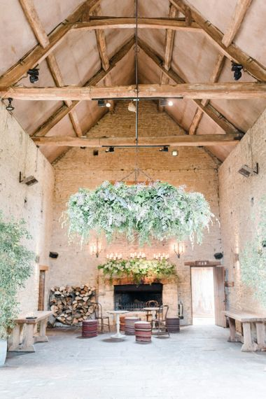 Cripps Barn Wedding Venue with Foliage Fireplace Decor and Hanging Hoop Chandelier
