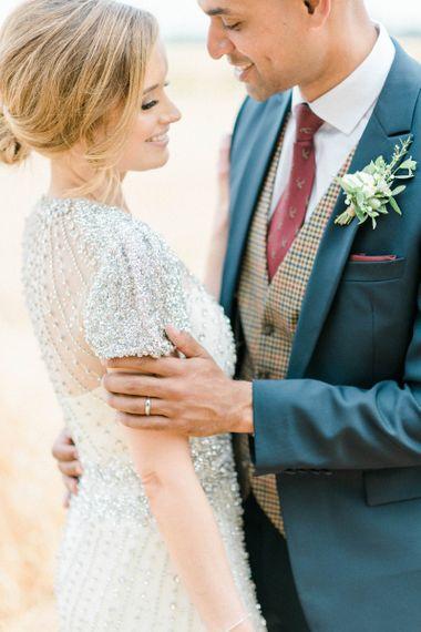 Bride in Beaded Wedding Dress and Groom in Dark Suit & Check Waistcoat