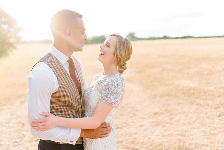 Sunset Portrait with Bride in Beaded Wedding Dress and Groom in Dark Suit & Check Waistcoat