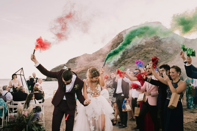 Spanish Beach wedding with smoke bombs