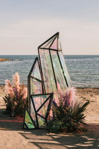 Iridescent geode structures at Spanish Beachj wedding