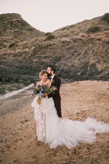 Bride and groom on Spanish beach