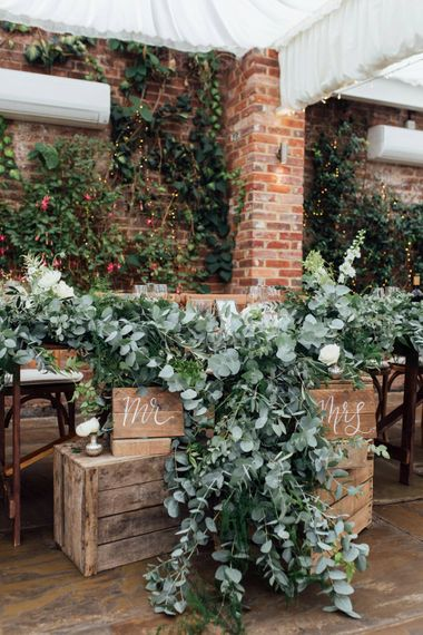 Top Table Heavy Eucalyptus Foliage with White Roses   French Rustic at Northbrook Park in Surrey   Images by Charlotte Bryer-Ash